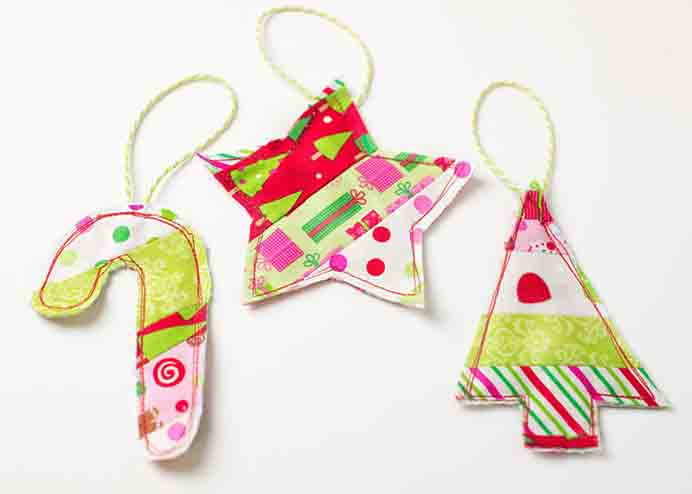 Follow Jamie's tutorial at Scattered Thoughts of a Crafty Mom to make these simple fabric gift toppers. Please share. Make Mondays more manageable and sign up for our craft inspiration newsletter. Delivered to your inbox - CraftyLikeGranny.com #christmascrafts #christmas #crafts #diy