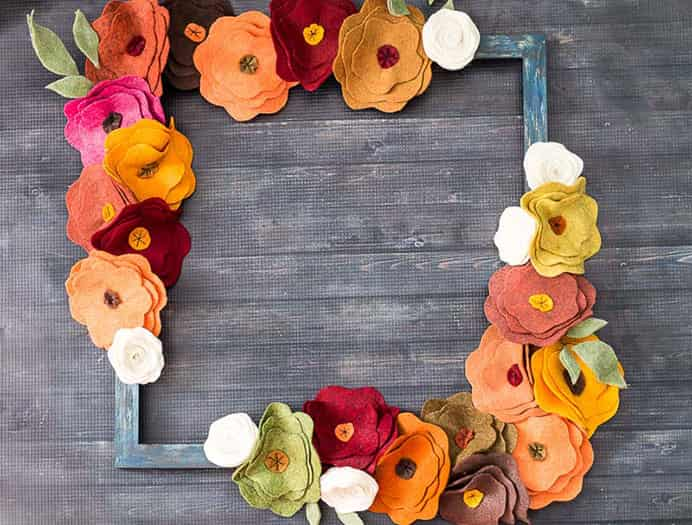 Felt-Flower-Wreath-Tutorial-Finished-Felt-Wreath by Hearth and Vine. Beautiful decoration for your home. Please share. Sign up to our craft inspiration roundup newsletter and make Mondays more manageable. Fabulous Crafty ideas and projects delivered to your inbox - CraftyLikeGranny.com