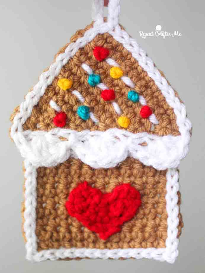 Gingerbread houses evoke memories of fairy tales and Christmas time. Sarah at Repeat Crafter Me has a gorgeous crochet pattern for creating Gingerbread House ornaments. Please share. Join now for creative craft inspiration. The best in craft delivered to your inbox every Monday - CraftyLikeGranny.com #crochet