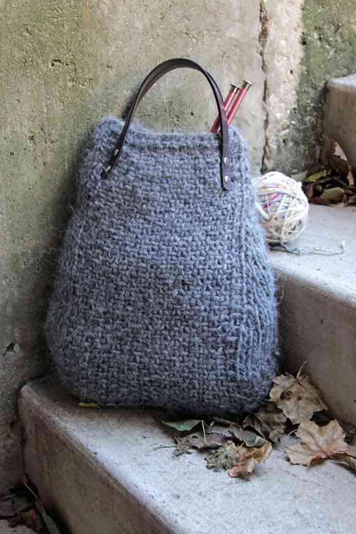 Such a fun knitted bag to carry all your knitted works in progress! Heidi from Hands Occupied shares her free Lopi Tote knitting pattern. Please share. Make Mondays more manageable and sign up for our craft inspiration newsletter. Delivered to your inbox - CraftyLikeGranny.com #knitting #totebag