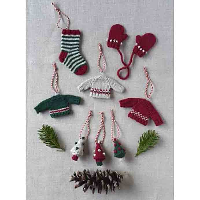 Susan B Anderson Holiday Charm Set Knitting Pattern. Knit Susan B Anderson's delightful Holiday Charm Set. The knitting pattern of a tiny Tree, the wee sweater, the mini-mittens and the little sock ornaments are all in one. Please share. Join now for creative craft inspiration. The best in craft delivered to your inbox every Monday - CraftyLikeGranny.com #knitting