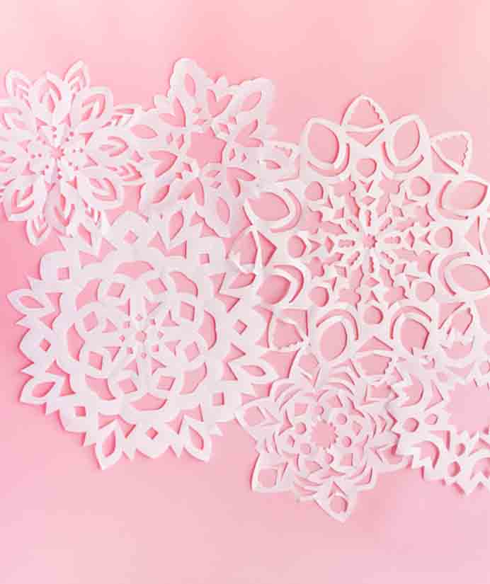 Giant Paper Snowflake. Such fun to make and still have on show through the colder months. This would make a great holiday activity for family members to to together. Please share and make Mondays fun, get our craft inspiration delivered to your inbox - CraftyLikeGranny.com #papercraft