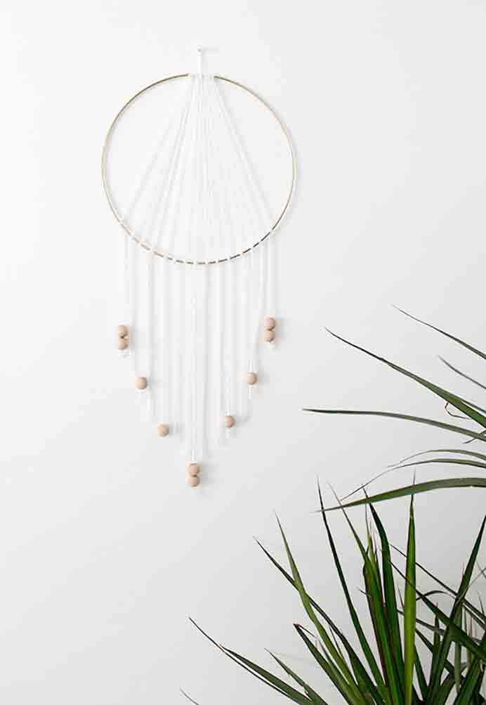 DIY Modern Dream Catcher. Simple and stylish and something that would add interest to any wall in your home. Follow Almost Makes Perfect's tutorial. Please share. Join now for creative craft inspiration. The best in craft delivered to your inbox every Monday - CraftyLikeGranny.com #DIY #craft