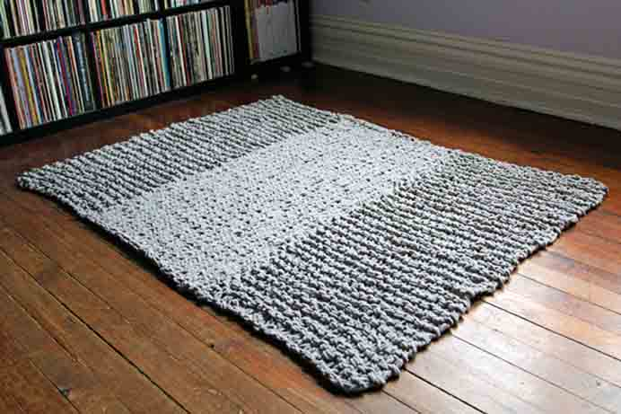 Knitted Bulky Rug. Big needles and bulky yarn are used to create this gorgeous rug. Heidi from Hands Occupied shares her pattern and tutorial. It makes a great project for those of you beginning to knit. Please share. You will always look forward to Mondays, with our craft inspiration roundups -CraftyLikeGranny.com #knitting