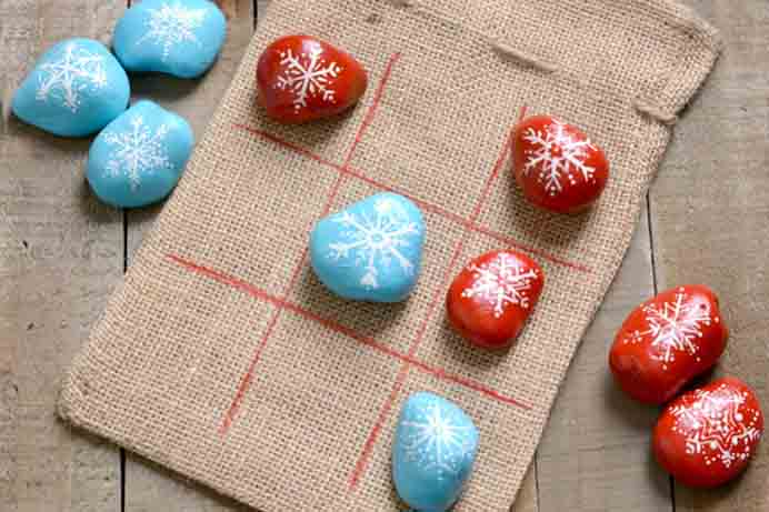 Painted Rocks DIY Tic Tac Toe Game. The team at Consumer Crafts have a tutorial for making this fun game with painted rocks. Follow their tutorial on how you can make it. Please share and make Mondays fun, get our craft inspiration delivered to your inbox - CraftyLikeGranny.com #DIY #Games #Craft