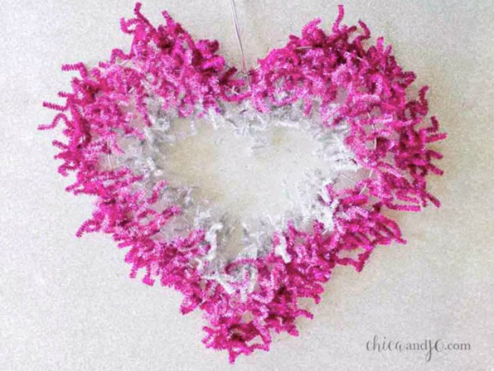 Simple DIY Valentine Day Wreath Valentine's day is only 4 weeks  away! An inexpensive and simple DIY project, by Chica and Jo to bring a bit of Valentine Day love into your home. Please share. You will always look forward to Mondays, with our craft inspiration roundups -CraftyLikeGranny.com #DIY #Craft