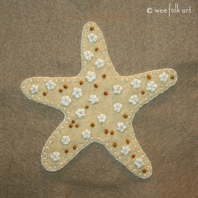 Beachy Embroidery The beach inspires many of us with its beauty. This Starfish Applique uses simple embroidery designs and looks gorgeous. Try Wee Folk Art's french knot and woven spider stitches to create texture and interest. Please share and make Mondays fun, get our craft inspiration delivered to your inbox - CraftyLikeGranny.com #embroidery