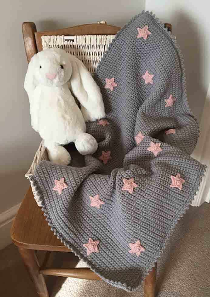 Baby Star Blanket. Kate from Just Pootling shares her crochet pattern for this gorgeous baby blanket design. The crocheted stars are so cute and simple to do :)Please share. The best in craft delivered to your inbox every Monday - CraftyLikeGranny.com #crochet