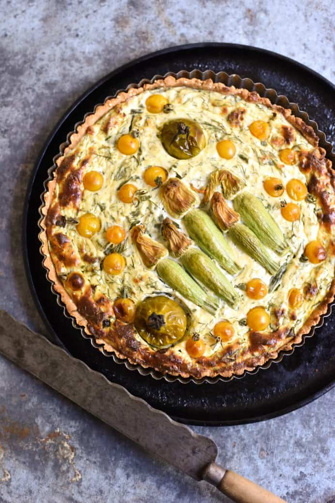 Dill Basil Zucchini Flower and Tomato Tart George Eats. Tarts are a great way to pack in lots of delicious ingredients. This tart is made with a simple and easy gluten free pastry. The combination of herbs and tomatoes in this tart by George Eats will be a sure winner! Please share. The best in craft delivered to your inbox every Monday - CraftyLikeGranny.com #recipes