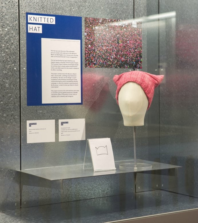 Pink Pussy Hat exhibited at the V&A Museum in London. The Pink Pussy hat Project was established for the 2017 Women's March. It's an ongoing movement that uses design to create social change, and inspires people who have felt invisible, feel visible. Please share. Join now for creative craft inspiration. The best in craft delivered to your inbox every Monday - CraftyLikeGranny.com #knitting #craftivism #craft