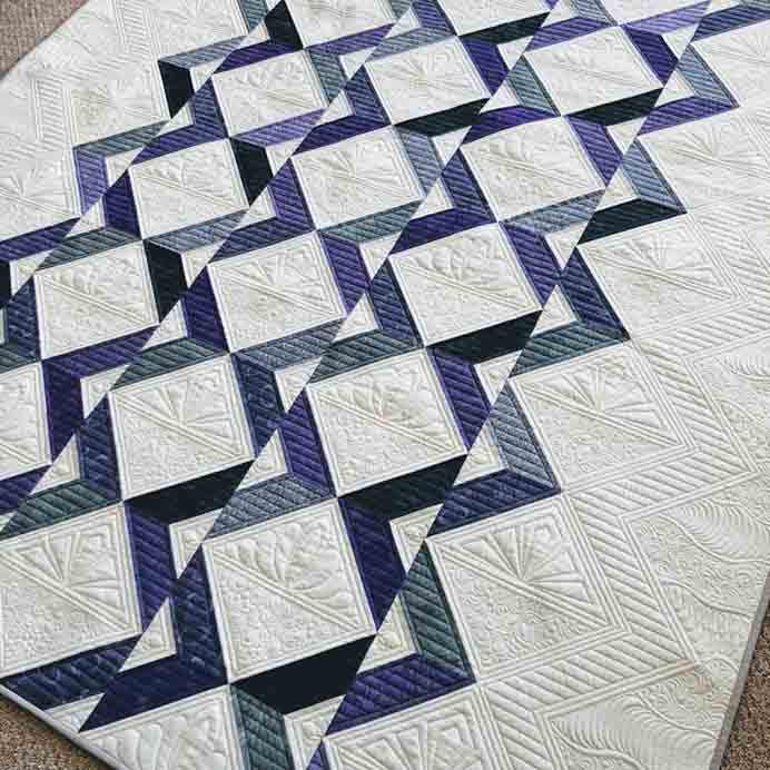 Refraction Quilt.A beautiful kaleidoscope effect is created in this quilt. The first for Liz at Savor Every Stitch for this year. Isn't it beautiful? Read more here. Please share. Look forward to Mondays with our craft inspiration newsletter. Crafty goodness delivered to your inbox - CraftyLikeGranny.com #quilting #quiltingtips #quiltingpatterns
