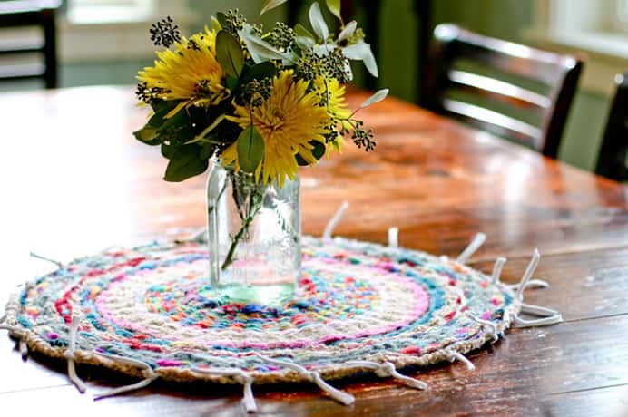Woven Finger Knitting Hula Hoop Rug. This fabulous project really caught my eye and I just love color. Anne Weil at Flax and Twine is famous for her Knitting Without Needles projects. This rug was made with a massive ball of finger knitting. In Anne's tutorial she shares how you can make the rug and how to finger knit. Please share. Join now for creative craft inspiration. The best in craft delivered to your inbox every Monday - CraftyLikeGranny.com #fingerknitting #craft #DIY