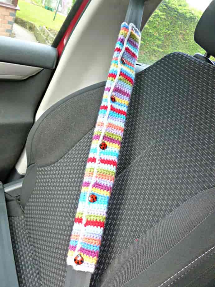 Crochet Car Seat Belt Cover. What a great idea! Christine from Winwick Mum steps you through how she made a crocheted seat belt cover. Perfect for using up scraps of yarn you've got hanging around. Please share. The best in craft delivered to your inbox every Monday - CraftyLikeGranny.com #crochet #crochetpatterns #crochetforbeginners