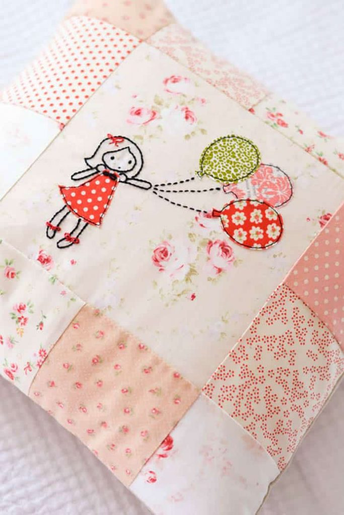 Balloon Girl Embroidery Tutorial. Such a lovely embroidery design used in a patchwork cushion. Sedef from Down Grapevine Lane shares her pattern and tutorial.Please share and make Mondays fun, get our craft inspiration delivered to your inbox - CraftyLikeGranny.com #Embroidery #quilting #sewing