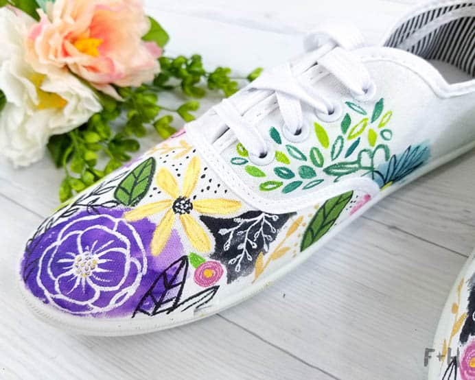 DIY Painted Canvas Sneakers. Art for shoes :) The ideas are endless for painting your own canvas shoes. Torrie from Fox and Hazel has created a beautiful floral theme. Check out her tutorial.Please share. You will always look forward to Mondays, with our craft inspiration roundups -CraftyLikeGranny.com #Art #Craft #DIY
