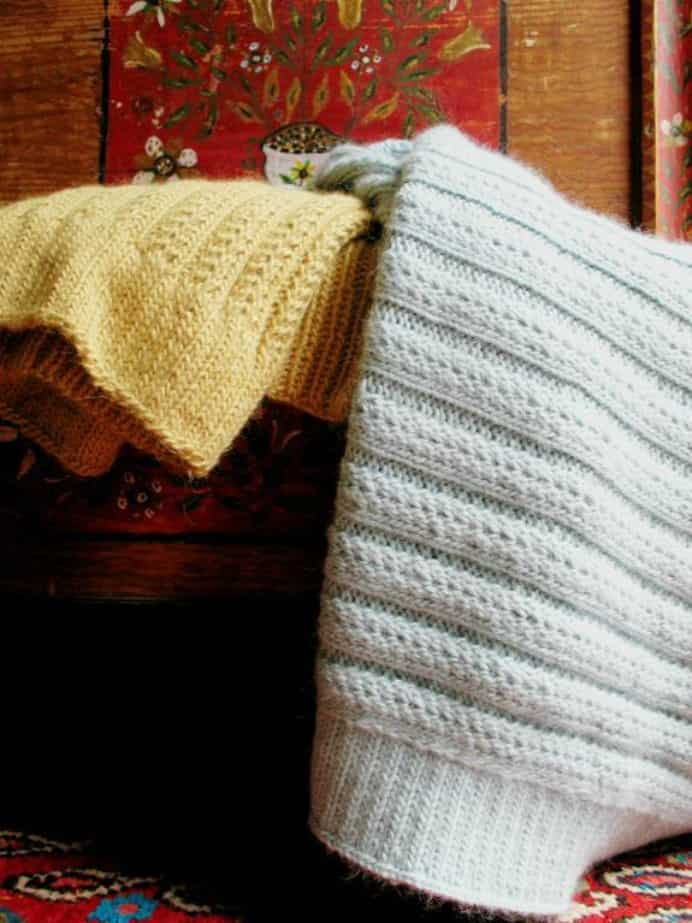 Knit Up A Cozy Blanket for Mom. In amongst these lovely handmade Mother's Day Gift ideas from Crafsty, I found this gorgeous pattern. Cozy and snug merino yarn is used to make a treasured blanket.Please share and make Mondays fun, get our craft inspiration delivered to your inbox - CraftyLikeGranny.com #knittingpattern #knitting #mothersdaygift