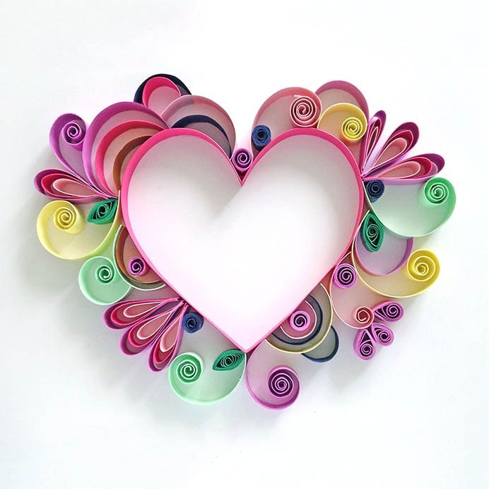Mother's Day Quilled Paper Art. A stunning design that would make a beautiful card or wall art for Mom. Emily Dawe takes you on a paper quilling journey in her wonderful tutorial on The Paperchase. Please share and make Mondays fun, get our craft inspiration delivered to your inbox - CraftyLikeGranny.com #papercrafting #papercraft #mothersdaygift
