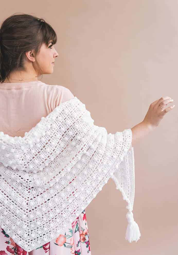 Le Nuage Wrap Crochet Pattern. A beautiful crocheted shawl which looks so romantic. Ashleigh has created this design which can be worn over the shoulders or bunch around the neck. It's a beginner friendly project, with simple stitches and an easy repeating pattern. Please share. Join now for creative craft inspiration. The best in craft delivered to your inbox every Monday - CraftyLikeGranny.com #crochet #crocheting #crochetpattern
