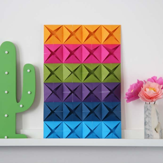 Paper Art can look so effective and this simple origami wall art is no exception. The paper folding is simple to do and you could choose any colors that you love in your home. Follow Emma from Gathering Beauty's step by step instructions to create your own. Please share. The best in craft delivered to your inbox every Monday - CraftyLikeGranny.com #paperart #papercraft #paper