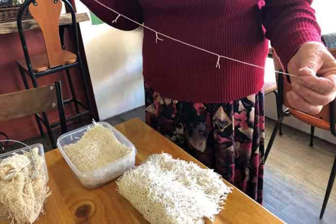 Woman Makes Scarves Out Of Teabag Strings. The patience required for creating this craft! What a woman! Sheer dedication to the reduction of waste. Read more of Irene's crafty story. Please share. The best in craft delivered to your inbox every Monday - CraftyLikeGranny.com #knitting #knit #knitting_inspiration