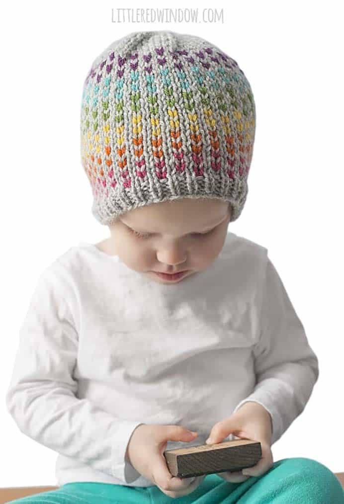 Rainbow Dots Hat Knitting Pattern. For the little people in your life. A super cute Rainbow Dots Knitted Hat Pattern by Cassie from Little Red Window. Please share. Make Mondays more manageable and sign up for our craft inspiration newsletter. Delivered to your inbox - CraftyLikeGranny.com #knitting_inspiration #knitting #craft #knittingguru