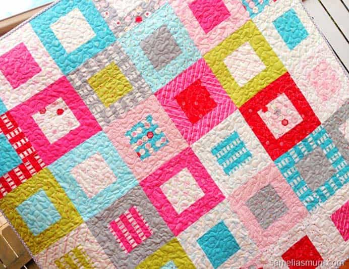Sew Stitchy Squares Quilt. Anorina's Sew Stitchy quilt is so sweet. Looks like a great design for a beginner. Follow her tutorial on how to make this quilt. Please share and make Mondays fun, get our craft inspiration delivered to your inbox - CraftyLikeGranny.com #sewing #sewingtips #sewingpattern