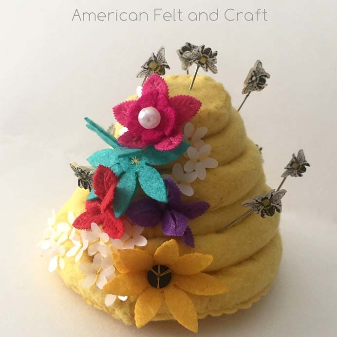 Beehive Pincushion and Honeybee Pins. What an adorable pairing of craft, a beehive pincushion and honeybee pins. Follow American Felt and Craft's tutorial on how to make them. Please share. Sign up to our craft inspiration roundup newsletter and make Mondays more manageable. Fabulous Crafty ideas and projects delivered to your inbox - CraftyLikeGranny.com #craft #DIY #felt #sewing