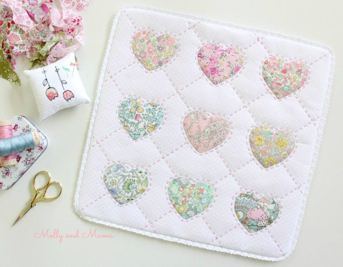Lauren at Molly and Mama shares her journey of making Elise and Emelie's free pattern for a Hearts of Friendship mini quilt. Please share. You will always look forward to Mondays, with our craft inspiration roundups -CraftyLikeGranny.com #quilitng #quiltblock #sewing