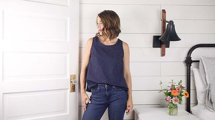 Learn to sew your own comfortable and simple tank by using a tank top you already love. Follow Lisa's tutorial on Farmhouse On Boone which includes a helpful video of the steps. Please share and make Mondays fun, get our craft inspiration delivered to your inbox - CraftyLikeGranny.com #sewingtutorial #sewingpattern #sewingtip