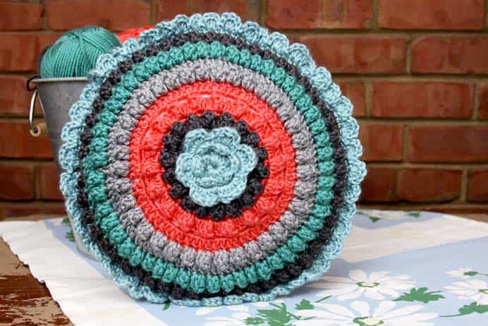 Retro Look Crocheted Pillow Pattern. Popcorn circles are used to create Beverly from Flamingo Toes crocheted pillow pattern. She loves how the design has a 'retro look'. Beverly shares the pattern in her post here. Please share. Join now for creative craft inspiration. The best in craft delivered to your inbox every Monday - CraftyLikeGranny.com #crochet #crocheting #crochetpattern