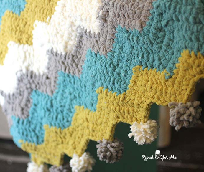 Using Bernat Blanket Stripes yarn, Sarah from Repeat Crafter Me was inspired to create a Chevron blanket. In her post she shares a free pattern and instructions for a car seat size and also how you can make a larger blanket. Please share. Look forward to Mondays with our craft inspiration newsletter. Crafty goodness delivered to your inbox - CraftyLikeGranny.com #crochetpattern #crochet #crocheting