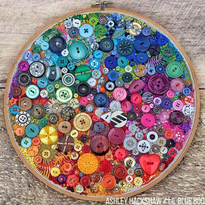 "One Year Of Stitches and Buttons Embroidery Hoop. I am in awe of Ashley's stunning embroidery with buttons masterpiece. It took her a whole year to complete! In her post she shares her design process. I loved seeing the photos of each stage and the glorious color scheme she used. A craft project I am definitely adding to my ""want to do"" list :) Please share. You will always look forward to Mondays, with our craft inspiration roundups -CraftyLikeGranny.com #embroidery #embroider #needlecraft"