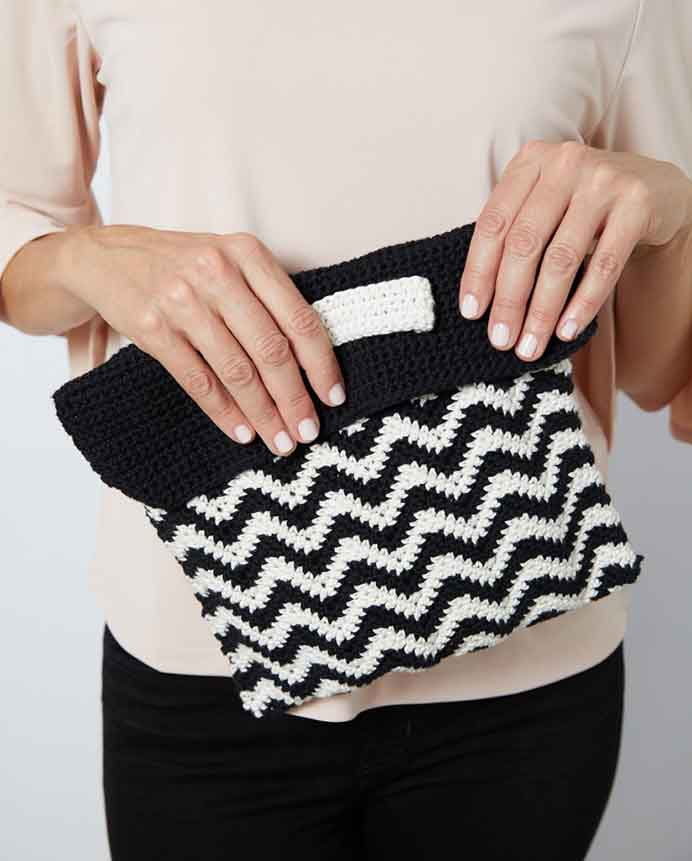 Show Off Your Handmade Style. Clutch bags are fashionable right now. Why not make your own stylish crocheted one using a Chevron design. Follow the instructions on Stitch 11. Please share. Join now for creative craft inspiration. The best in craft delivered to your inbox every Monday - CraftyLikeGranny.com #crochet #crocheting #crochetpattern