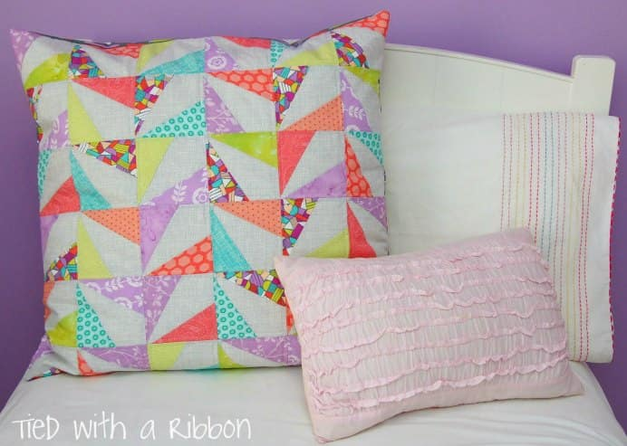 Jemima from Tied with a Ribbon steps you through her quilted confetti cushion. Such a colorful and cheery design that would jazz up any bedroom :)Please share. The best in craft delivered to your inbox every Monday - CraftyLikeGranny.com #quilting #quiltblock #sewing