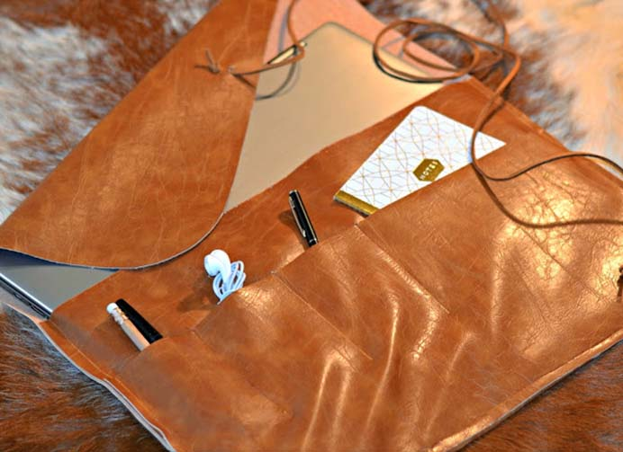 DIY Leather Laptop Sleeve Tutorial. A very cool looking laptop sleeve that you can create yourself! Follow Rachel's tutorial on how to put together one made from leather. Please share. Look forward to Mondays with our craft inspiration newsletter. Crafty goodness delivered to your inbox - CraftyLikeGranny.com #DIY #leathercraft #craft