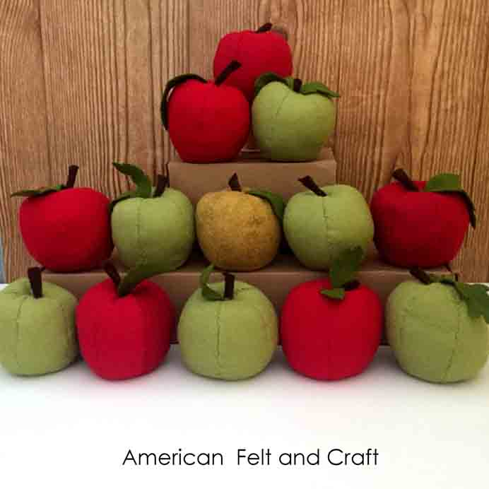 Felt Apples For Fall. Follow American Felt and Crafts' tutorial and learn the overcast stitch to make these felt apples. Please share. Sign up to our craft inspiration roundup newsletter and make Mondays more manageable. Fabulous Crafty ideas and projects delivered to your inbox - CraftyLikeGranny.com #feltcraft #diy #fallcrafts