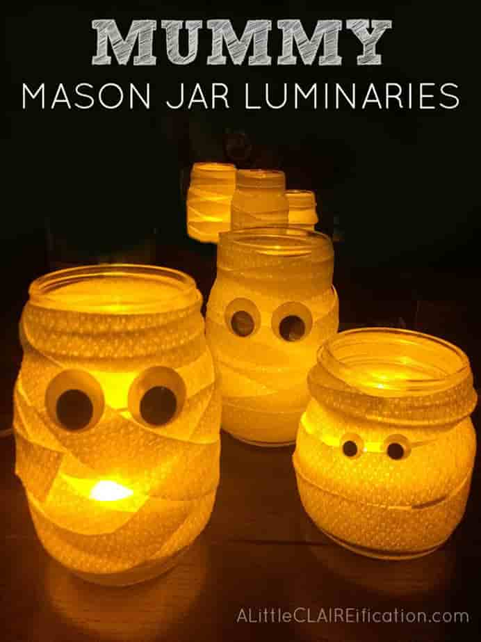 Mummy Mason Jar #Luminaries Cutest and Easiest Halloween Crafts Ever and they make fun candy jars too by A Little Claireification. Please share. The best in craft delivered to your inbox every Monday - CraftyLikeGranny.com #halloweencrafts #masonjarcraft #diy