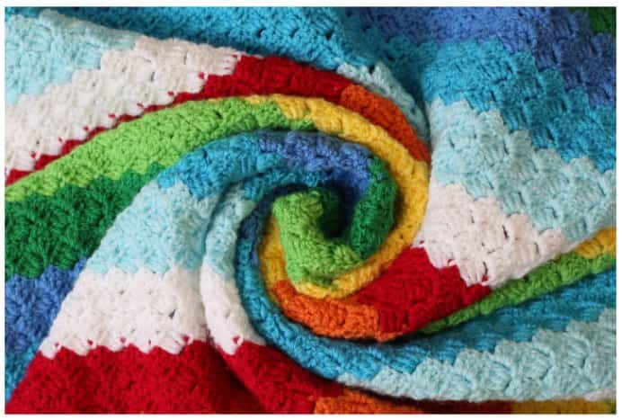 Lovely colorful inspiration for crocheted cot blankets. Heather from Little Tin Bird suggests these size of blankets are perfect for 'sneaking time' crochet. Moments where you have a little bit of time to sneak in some crochet. Please share. Make Mondays more manageable and sign up for our craft inspiration newsletter. Delivered to your inbox - CraftyLikeGranny.com #crochet #crochetpattern #babyblanket