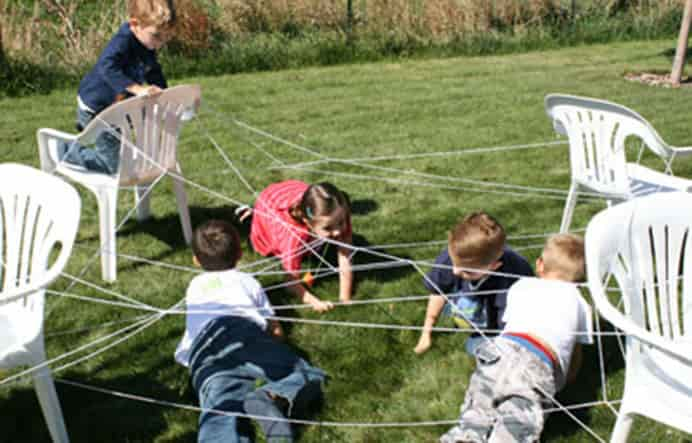 Crawl Giant Spider Web. Creating a spider web by using outdoor chairs, some white yarn and enthusiastic little ones is all it takes. Please share. The best in craft delivered to your inbox every Monday - CraftyLikeGranny.com #halloweencrafts #kidscrafts