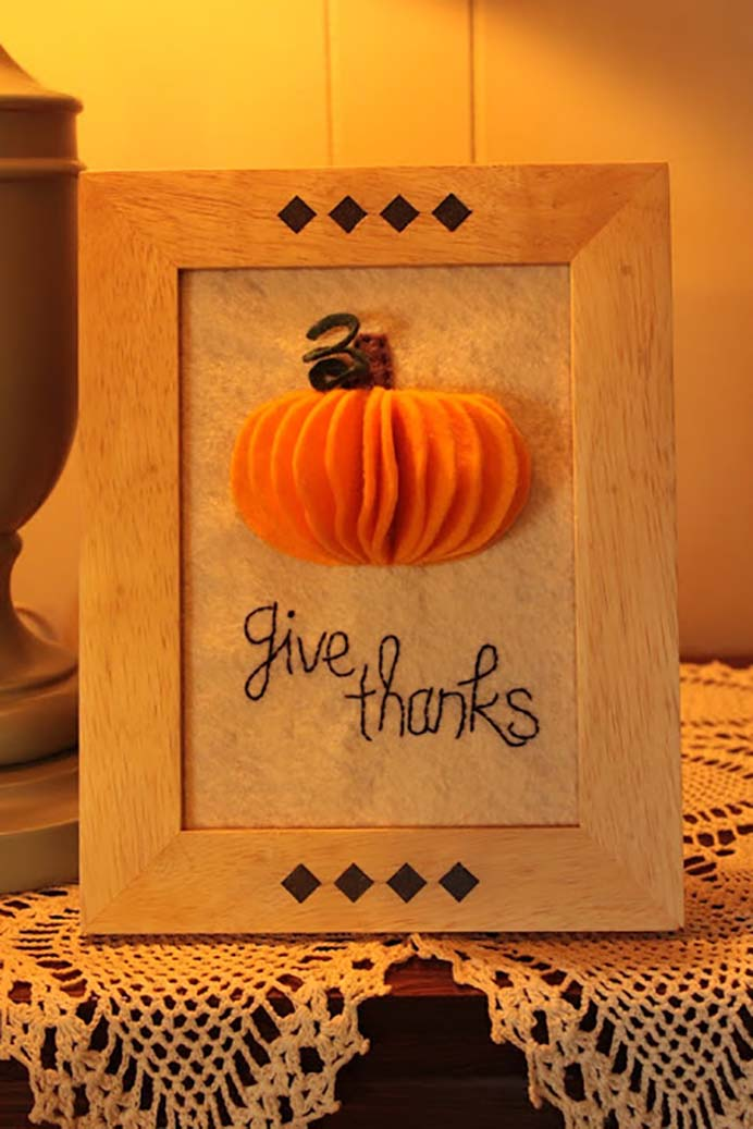 "3D Pumpkin Felt Art. Such a lovely and simple Thanksgiving wall art idea. Using felt to make a 3D pumpkin and some embroidery to say ""Give Thanks"" Follow Allison's tutorial on Simple Serendipities. Please share. Join now for creative craft inspiration. The best in craft delivered to your inbox every Monday - CraftyLikeGranny.com #thanksgivingcrafts #feltcraft #DIY"