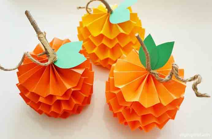 Forget Carved Pumpkins Make Paper Ones Instead. These paper pumpkins would look great as a table centerpiece or used as decorations on your mantelpiece. Dinah from DIY Inspired has step by step instructions to create them. Please share. Make Mondays more manageable and sign up for our craft inspiration newsletter. Delivered to your inbox - CraftyLikeGranny.com #halloweencrafts #papercraft #diy