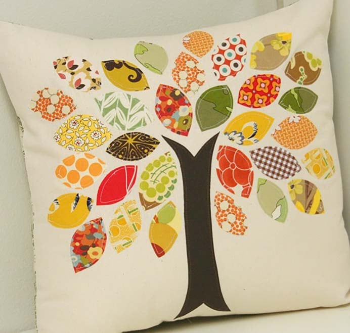 Scrap Buster Fall Inspired Pillow. Decorate your couches with a fall inspired pillow during Thanksgiving. A great way to use up your scrap fabric pieces and the tree comes up a treat :) Follow Allison's instructions on Cluck Cluck Sew. Please share. Join now for creative craft inspiration. The best in craft delivered to your inbox every Monday - CraftyLikeGranny.com #thanksgivingcrafts #fallcrafts #sewing