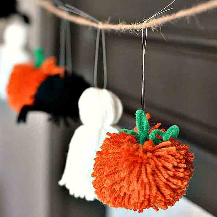 Pom poms All Spooked Up! Using pom poms to create three different Halloween themed items. A spider, ghost and a pumpkin. Super easy and when hung together in a garland, they look so effective! Follow Camille's detailed tutorial on Growing Up Gabel. Please share and make Mondays fun, get our craft inspiration delivered to your inbox - CraftyLikeGranny.com #halloweencrafts #craft #diy