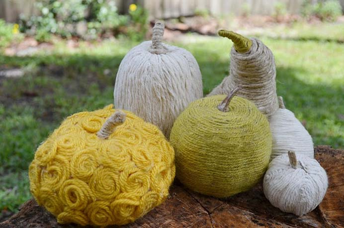 Yarn Wrapped Pumpkin Decorations. This is a clever idea for using up scrap bits of yarn and creating a wonderful display for Thanksgiving. I love the spiral rosettes. Follow Jessica's tutorial on Two Shades of Pink. Please share. You will always look forward to Mondays, with our craft inspiration roundups -CraftyLikeGranny.com #Thanksgivingcrafts #diy #crafts