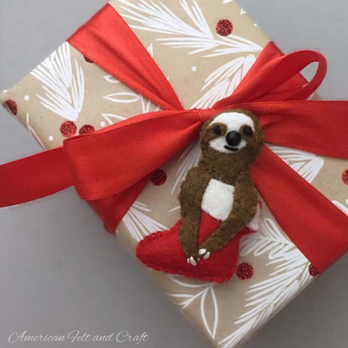 Slowly Slowly. I would never have thought of a Sloth being used as a Christmas ornament! These gorgeous creatures are made from felt and will bring a smile to those who admire your tree :) Follow American Felt and Craft's tutorial to make them. Please share. You will always look forward to Mondays, with our craft inspiration roundups -CraftyLikeGranny.com #christmascrafts #christmas #craft #diy