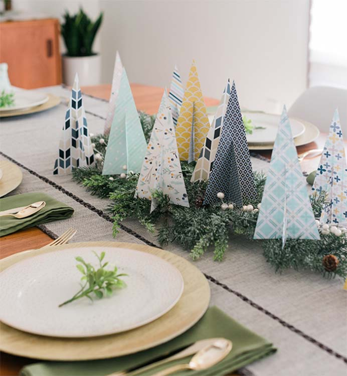 DIY Paper Christmas Tree Centerpiece. These cute paper Christmas Trees only take 20 minutes to make, creating a lovely centrepiece. Follow Carrie Waller's instructions on Dream Green DIY. Please share and make Mondays fun, get our craft inspiration delivered to your inbox - CraftyLikeGranny.com #papercraft #christmascrafts #diy