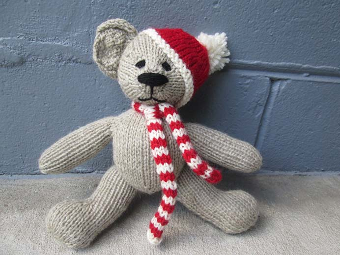Knit Up A Christmas Teddy Bear. Gregory's knitting pattern for this adorable Ted is easy to do. As he explains, it is simple to knit using double pointed needles. Buy the Limited Edition Christmas Bear Pattern from his shop for $2USD. Please share. Look forward to Mondays with our craft inspiration newsletter. Crafty goodness delivered to your inbox - CraftyLikeGranny.com #christmascrafts #christmas #craft #diy