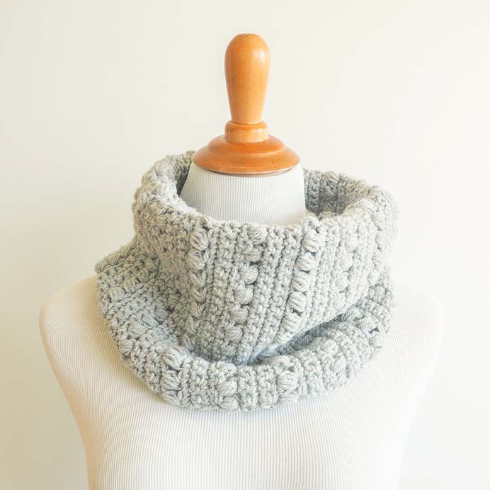 Warm Winter Cowl Crochet Pattern. The stitch design is lovely in this pattern. The use of a decorative puff stitch gives the cowl texture and interest. Please share. The best in craft delivered to your inbox every Monday - CraftyLikeGranny.com #crochet #crochetpattern #crocheting