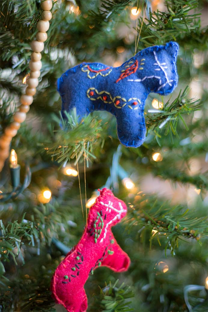 Stitched Dala Horse Christmas Ornaments. Hannah was inspired to create Swedish themed craft for these gorgeous Christmas ornaments. Follow her tutorial on The Homesteady. Please share. The best in craft delivered to your inbox every Monday - CraftyLikeGranny.com #christmascrafts #christmas #craft #diy