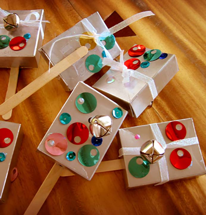 New Years Noise Makers. This New Year Eve craft project uses small recycled cardboard boxes. They are then decorated and filled with materials that make noise when shaken. Follow the tutorial on Alphamom. Kids will particularly enjoy making these. Please share. Look forward to Mondays with our craft inspiration newsletter. Crafty goodness delivered to your inbox - CraftyLikeGranny.com #newyears #newyearseve #diycrafts